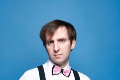 Portrait of handsome man in pink bow tie stock photos