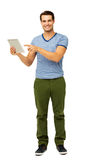 Portrait Of Handsome Man Pointing At Digital Tablet Stock Images