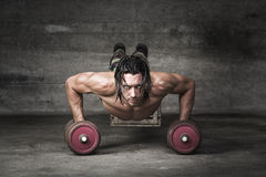 Portrait of handsome man pushing up. With weigths Royalty Free Stock Photography