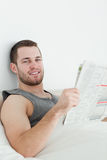 Portrait of a handsome man reading a newspaper Stock Photography
