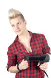 Portrait of handsome man in red with hairdryer Royalty Free Stock Photo