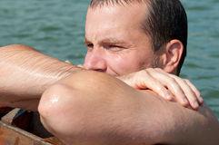 Portrait of handsome man resting after swimming Royalty Free Stock Images