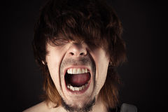 Portrait of a handsome man screaming Royalty Free Stock Image