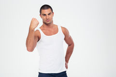 Portrait of a handsome man showing his fist. Isolated on a white background Stock Images