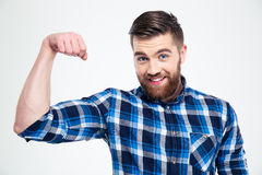 Portrait of a handsome man showing his muscles Royalty Free Stock Photo