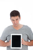 Portrait of a handsome man showing a tablet PC Stock Images