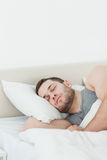 Portrait of a handsome man sleeping Royalty Free Stock Image