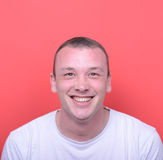 Portrait of handsome man smiling against red background Royalty Free Stock Photos