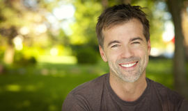 Portrait Of A Handsome Man Smiling At The Camera. At The Park Royalty Free Stock Images