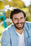 Portrait of handsome man smiling at camera Stock Images