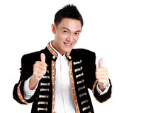 Portrait handsome man smiling ,Hand showing thumbs up isolated o Royalty Free Stock Photo