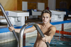 Portrait of a handsome man swimming Royalty Free Stock Photos
