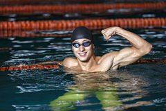 Portrait of a handsome man swimming Royalty Free Stock Image