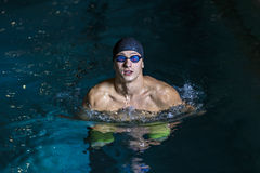 Portrait of a handsome man swimming Stock Images