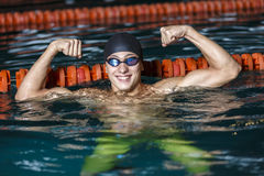 Portrait of a handsome man swimming Royalty Free Stock Images