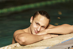 Portrait of a handsome man swimming Royalty Free Stock Photo