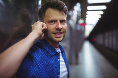 Portrait of handsome man talking on mobile phone Stock Photos