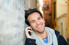 Portrait of handsome man talking on phone Royalty Free Stock Image