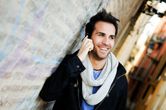 Portrait of handsome man talking on phone Stock Image
