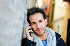 Portrait of handsome man talking on phone Royalty Free Stock Photography