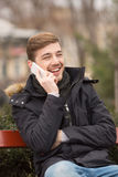 Portrait of handsome man talking on the phone Stock Photo