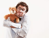 Portrait of handsome man with teddy bear stock images