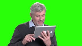 Portrait of handsome man using digital tablet. Mature man talking via skype on Alpha Channel background. People and modern technology stock video