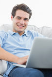 Portrait of a handsome man using his laptop Royalty Free Stock Photography