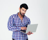 Portrait of a handsome man using laptop computer Royalty Free Stock Photo