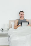 Portrait of a handsome man using a tablet computer Royalty Free Stock Photos