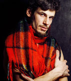 Portrait of handsome man warmed up in scarf, smiling closeup dark background Stock Photo
