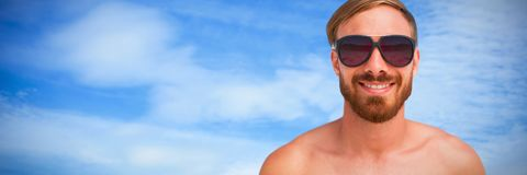Composite image of portrait of handsome man wearing sunglasses stock image