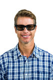 Portrait of handsome man wearing sunglasses. Against white background Royalty Free Stock Photos