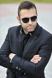 Portrait of handsome man wearing sunglasses - outdoors Royalty Free Stock Photography