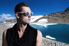 Portrait of a handsome man, wearing tinted sunglasses. Portrait of a young handsome man, wearing tinted sunglasses Royalty Free Stock Images