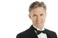 Portrait Of Handsome Man Wearing Tuxedo. Close-up portrait of handsome mature man wearing tuxedo isolated on white background Royalty Free Stock Photography