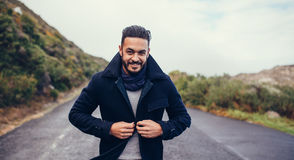 Handsome man on countryside highway Royalty Free Stock Photography