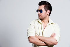 Portrait of handsome man in yellow shirt. Stock Photos