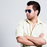 Portrait of handsome man in yellow shirt. Stock Photography