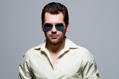 Portrait of handsome man in yellow shirt. Royalty Free Stock Photography