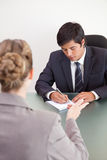 Portrait of a handsome manager interviewing a female applicant Stock Photos