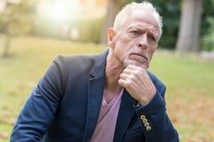 Portrait of handsome mature man, light effect. Portrait of handsome mature man, outdoors, light effect Stock Images