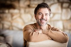 Portrait Of A Handsome Mature man smiling. royalty free stock photos