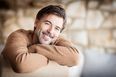 Portrait Of A Handsome Mature man smiling. stock photos