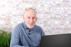 Portrait of a handsome mature man using laptop. At office Stock Photos