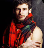 Portrait of handsome mature modern bearded hipster brutal man warmed up in scarf christmas colored, smiling, lifestyle Stock Images