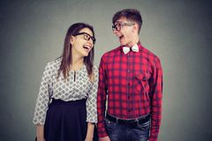 Portrait of a handsome man and cute girl looking at each other with wide smiles stock photos
