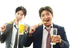 Portrait of handsome men drinking beer Stock Images