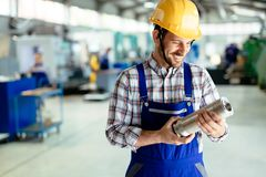 A portrait of handsome metal industry worker in factory Royalty Free Stock Photos