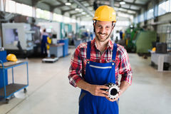 A portrait of handsome metal industry worker in factory stock photo